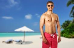 Man on beach at Maldives Royalty Free Stock Images