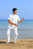 Man on the beach meditating Royalty Free Stock Photos