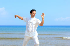 Man on the beach meditating Royalty Free Stock Image