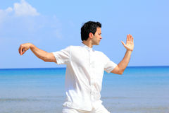Man on the beach meditating Royalty Free Stock Photo