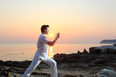 Man on the beach meditating Royalty Free Stock Images