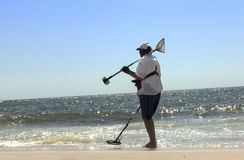 Man at beach with metal detector Royalty Free Stock Images