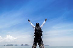 Man on beach and ocean view fog with his hands up relaxing enjoy Stock Photography