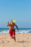 Man on the beach playing Frisbee Stock Photos