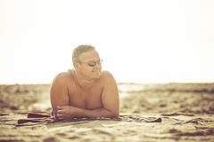 Man on a beach. Man relaxing on sandy beach Royalty Free Stock Photo