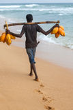 Man on the beach selling coconut water Royalty Free Stock Photo