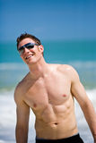 man at the beach with shades. Young handsome Caucasian man with sunglasses Stock Image