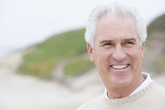 Man at the beach smiling Royalty Free Stock Photo