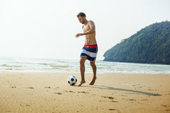Man Beach Summer Holiday Vacation Football Concept Royalty Free Stock Images