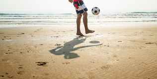 Man Beach Summer Holiday Vacation Football Concept stock photography