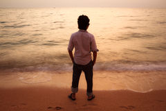 Man on the beach at sunset Royalty Free Stock Photography