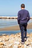 Man On The Beach Watching Over Horizon royalty free stock photo