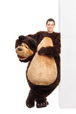 Man in a bear costume leaning on a wall Royalty Free Stock Image