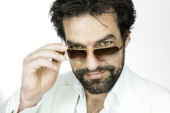 Man with beard. A handsome man with a beard and sun glasses stock image