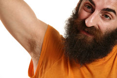 Man with beard. Man with orange t-shirt on white background stock photo