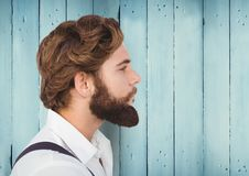 Man with beard against blue wood panel. Digital composite of Man with beard against blue wood panel Stock Images