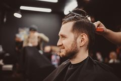 Man with beard in barber shop royalty free stock images