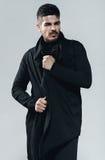 Man with beard in black coat Royalty Free Stock Photos