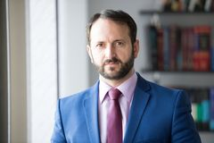 Man with beard in blue jacket, shirt and tie Royalty Free Stock Image