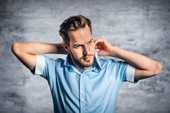 Man with beard in blue shirt. Portrait of young fashionable man with beard in blue shirt stock photo