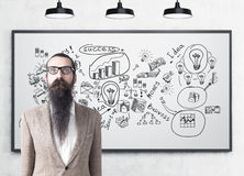 Man with beard and business scheme Stock Images