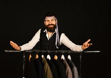 Man with beard by clothes rack. Tailoring and design concept royalty free stock images