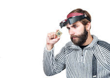 Man with beard considering a chip Stock Photo
