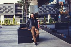 Man with beard. Dressing in black leather jacket Royalty Free Stock Photo
