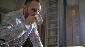 Man with a beard drinking tea.  stock video footage