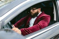 Man with beard driving a car Stock Photos