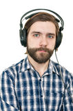 The man with a beard in earphones Stock Photography