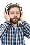 The man with a beard in earphones Royalty Free Stock Photography