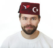 Man in the fez. Man with a beard in the fez Royalty Free Stock Image