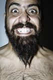 Man with beard with frightening expressions Royalty Free Stock Photos