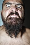 Man with beard with frightening expressions Royalty Free Stock Photography