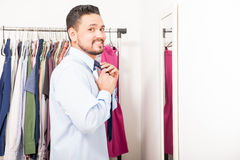 Man with a beard getting dressed Stock Image