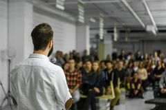Man gives a conference stock photo