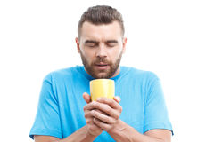 Man with beard holding cup of coffee Stock Image
