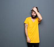 Man with beard holding hat Royalty Free Stock Images