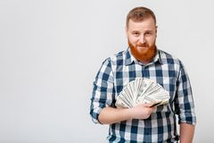 Man with beard holding lot of hundred-dollar bills stock images