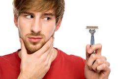 Man with beard holding razor Stock Photos