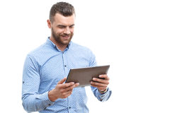Man with beard holding tablet Royalty Free Stock Photography