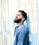 Man with beard listening to music Royalty Free Stock Image
