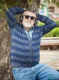 Man with beard listening to music. In a par Royalty Free Stock Images