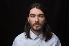 Man with beard and long hair looking at camera Royalty Free Stock Images
