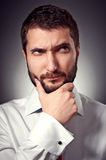 Man with beard looking up Stock Photo