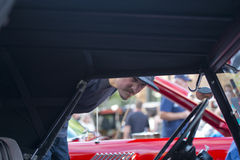 Man with beard looking vintage car on retro car exhibition Stock Photo