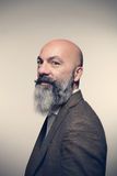 Man with beard. Middle-aged man with beard, studio portrait royalty free stock photography