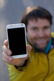 Man with beard and mobilephone Stock Photos