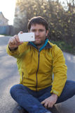 Man with beard and mobilephone. The man with beard and white mobilephone Stock Images